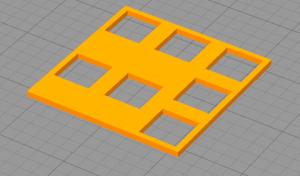 Vasen peukaloklusteri 3d-mallina. Paikat kahdelle pystysuuntaiselle painikkeelle vierekkäin ja niiden yläpuolella ja oikealla puolella yhteensä 5 muuta normaalikokoista näppäinpaikkaa